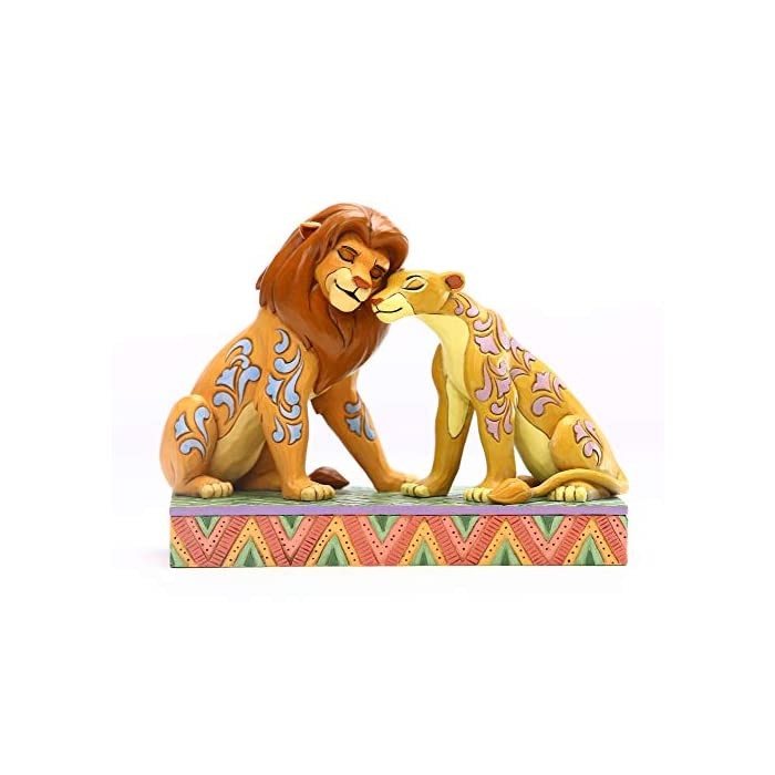 51dwUzvluQL Figura de Disney Traditions. Diseñado por Jim Shore. Patrones inspirados en arte popular con colores llamativos.