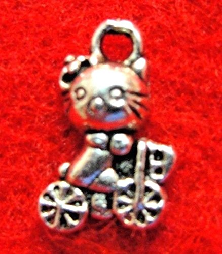 100Pcs. Wholesale Tibetan Silver Kitty CAT On Bike Charms Earring Drops Q1302 Crafting Key Chain Bracelet Necklace Jewelry Accessories Pendants