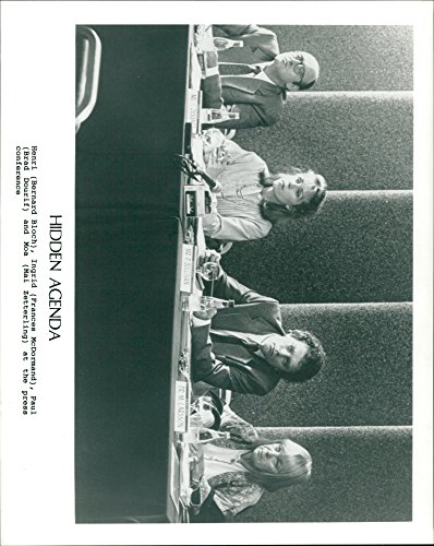 """Over the hill photo of Bernard Bloch, Frances McDormand as Ingrid, Brad Dourif as Paul and Mai Zetterling at press conference in 199039;s film """"Cryptic Agenda"""""""