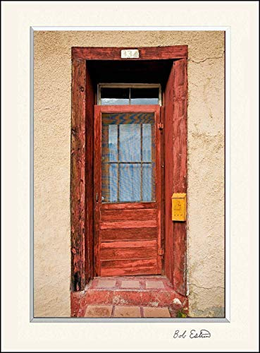 11 x 14 inch mat including a photograph of of very colorful red American Southwest door on adobe wall with yellow mailbox.