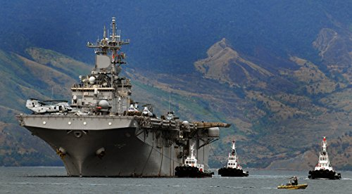 Home Comforts The USS Essex is Guided Philippine tug Boats as it Enters Port at The Former (Subic Naval Base) n