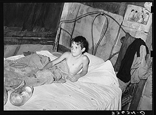1939 Photo Young son of agricultural day laborer in bed. Near Vian, Oklahoma, Sequoyah County Location: Oklahoma, Sequoyah County, Vian