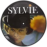 Picture disc format. Sylvie Vartan's seminal 1962 debut LP transformed the 18-year-old collegienne du twist into the French pop diva, whose songs (and high-profile marriage to Johnny Hallyday) would dominate the European pop charts throughout...