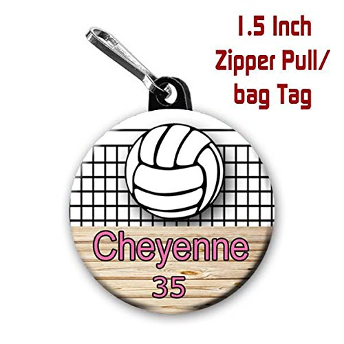 (Two Volleyball zipper pull bag tags with 1.5 inch charms personalized with name and number)