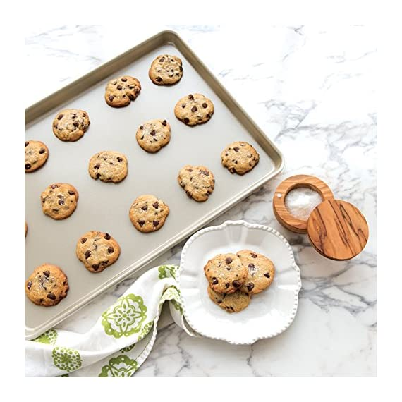 "Nordic ware big sheet naturals aluminum, 21"" x 15"", nonstick 2 large surface area and fits in standard oven baked goods rise and bake evenly due to aluminums superior heat conductivity and the reinforced encapsulated steel rim prevents warping nonstick interior for easy realease and clean-up, hand wash only"