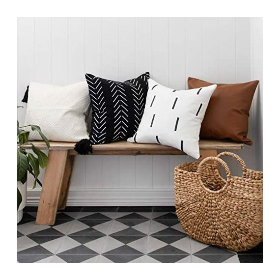 """Throw Pillow Covers and Cases, Set of 4, 18"""" x 18"""" - Modern, Boho, Decorative Cover Sets for Pillows - Couch, Bed, Home Decor - Variety Case Collection of Unique Bedding and Accessories - A TOUCH OF CLASS: Meet Inspired Ivory's deluxe line of linen and faux leather pillow cases - the perfect collaboration of decorative throw covers for living rooms, bedrooms, nurseries, or even commercial use in hotels, lobbies, spas, or doctor's offices. At 18"""" x 18"""", these four cases fit standard throw pillows and are as equally pleasing to the touch as they are to the eye. Furthermore, their simple yet unique designs offer the perfect enhanced touch to any room. FOUR COVERS, LIMITLESS OPTIONS: With your purchase of the Inspired Ivory throw pillow collection, you receive: a brown faux leather case, a textured white case with black tassels, a black case with a Bohemian inspired pattern, and a white case with black lines. Collectively, this bedding looks sleek and sophisticated, but can individually be used interspersed throughout the house. These pillow covers are meant to add beauty to any area - regardless of the motif or interior design OUTLASTING DURABILITY AND COMFORT: Each throw pillow case boasts stunning aesthetics coupled with unrivaled quality and artistry. We use 100% animal safe materials like cotton and faux leather. The fabrics are reinforced with beautiful stitching, lending themselves to outlasting performance over the years. Even with pets, kids, and house guests - your new toss pillow covers will maintain their integrity and looks when subjected to everyday wear-and-tear. - living-room-soft-furnishings, living-room, decorative-pillows - 51eD1lfUrJL. SS570  -"""