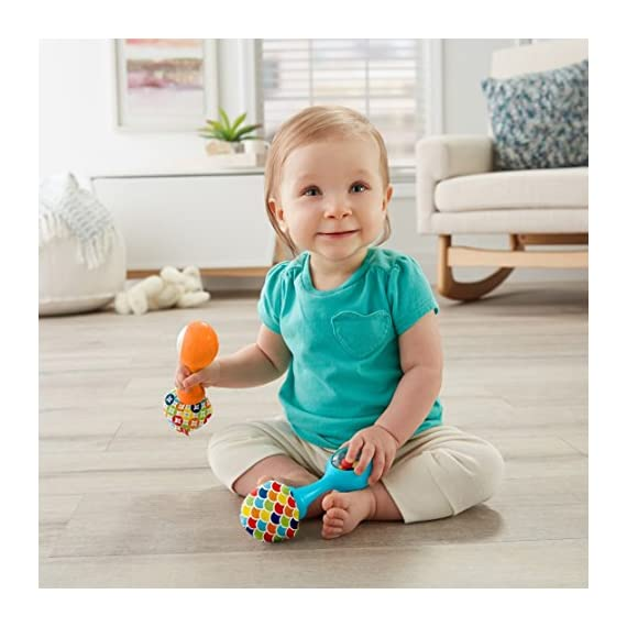 Fisher-Price Rattle 'n Rock Maracas, Blue/Orange [Amazon Exclusive] 3 Includes 2 toy maracas Sized just right for little hands to grasp and shake Colorful beads make fun rattle sounds when shaken