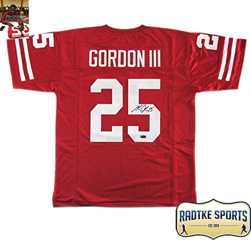 A Wisconsin Badgers Custom Red Jersey Hand Signed By Melvin Gordon. The  Signature and item de2d814e6