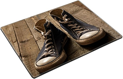 MSD Place Mat Non-Slip Natural Rubber Desk Pads Design: 34965140 Dirty gumshoes on Wooden Background -
