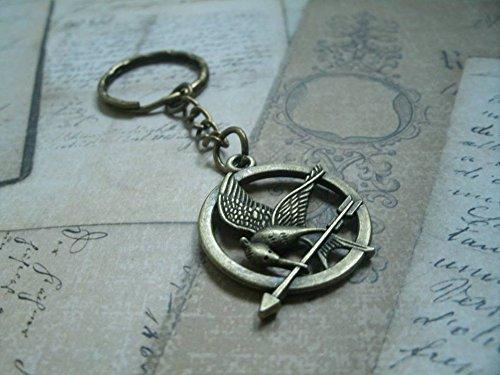 portachiavi / orecchini / cinghie / collana jay di derisione Hunger Games -  Mockingjay