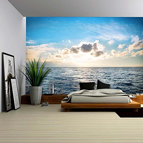 wall26 – Sea with Blue Water, Sky and Clouds. Sunset Above Seascape – Removable Wall Mural | Self-adhesive Large Wallpaper – 100×144 inches