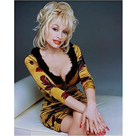 Dolly Parton In Yellow Leaved Dress And Black Fur Lined Cleavage