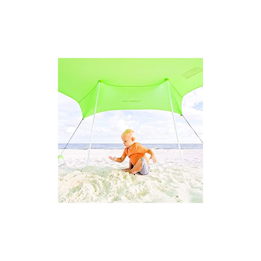Best XL Portable Beach Shade, Sun Shelter, Canopy Sail Tent, Large Sunshade Includes Carrying Bag, 2 Poles, 2 Stakes For Park / Grass Use, Elastic Lycra Sail, and 4 sandbags.