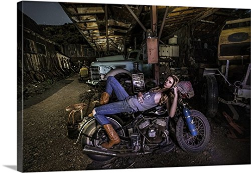 Scott Stulberg Premium Thick-Wrap Canvas Wall Art Print entitled Blonde girl laying on an old Harley Davidson (Scott Vintage Range)