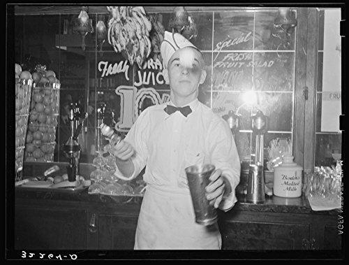 Soda jerker flipping ice cream into malted milk shakes. Corpus Christi, Texas