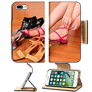 Luxlady Premium Apple iPhone 7 Plus Flip Pu Leather Wallet Case iPhone7 Plus 8253526 Young woman trying on new shoes in a store
