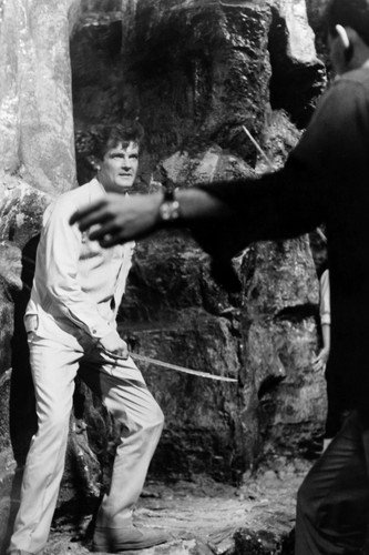 Roger Moore in The Saint holding sword about to fight villain 24x36 Poster