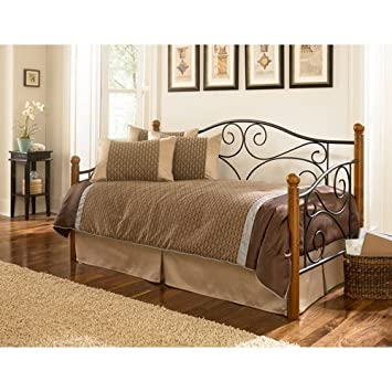 doral metal daybed frame with scrolled spindle panels and walnut hardwood finial posts matte black