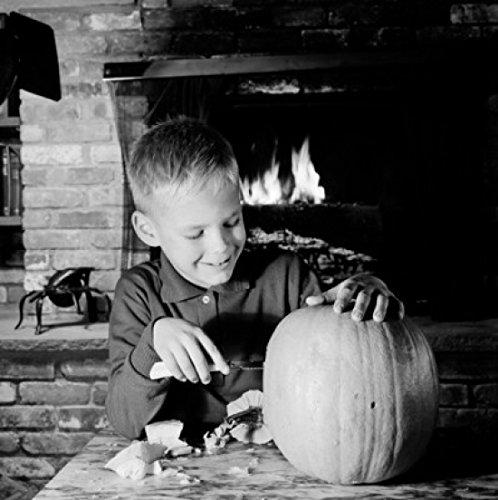 Boy preparing pumpkin for Halloween Poster Print (24 x 36) -