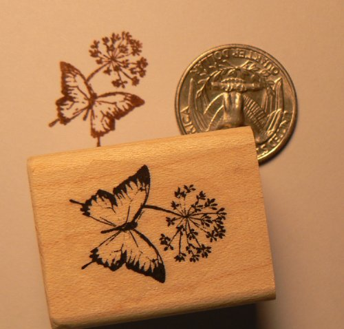 Miniature butterfly on flower rubber stamp