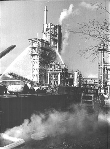 (Vintage photo of Gas explosion in refinery. After a quarter the fire in the refinery was under control)
