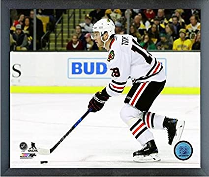 Amazon.com  Jonathan Toews Chicago Blackhawks 2016-2017 NHL Action ... f27c0375e