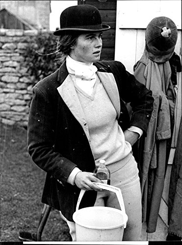 Vintage photo of Mark Phillips39;s sister Sarah helps in the stables at Wilkshire village ()
