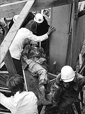 Vintage photo of One of the injured at the concrete slump in Rosenlund hospital is helped off by (Concrete Slump)