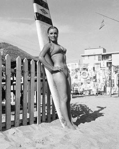 Sharon Tate in Don't Make Waves barefoot bikini by surfboard on California beach 16x20 Poster
