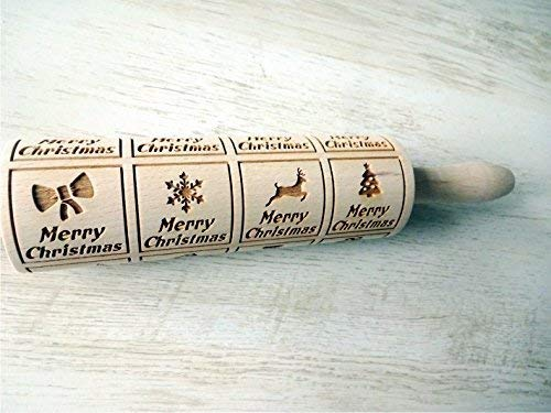 CHIRISTMAS WINDOWS Rolling pin Embossing rolling pin with Merry Christmas. Christmas gingerbread cookies.