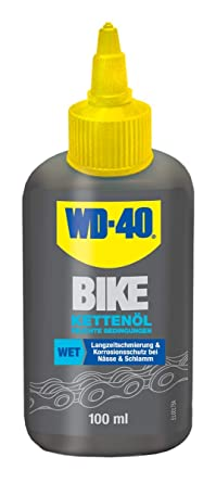 Aceite cadena wet wd-40 bike botella 100ml: Amazon.es: Industria ...