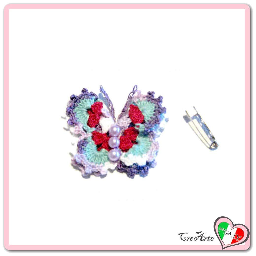 Mariposa lila, aguamarina y roja para aplicaciones, broche o ...