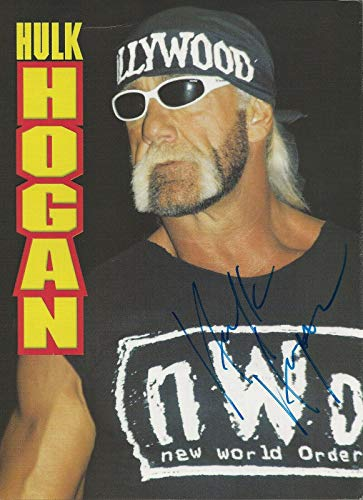 Hulk Hogan REAL hand SIGNED Magazine Page COA WWE Wrestler