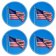 MSD Natural Rubber Round Coasters IMAGE 23128957 A weathered American flag waving in the wind on a flagpole against a blue sky