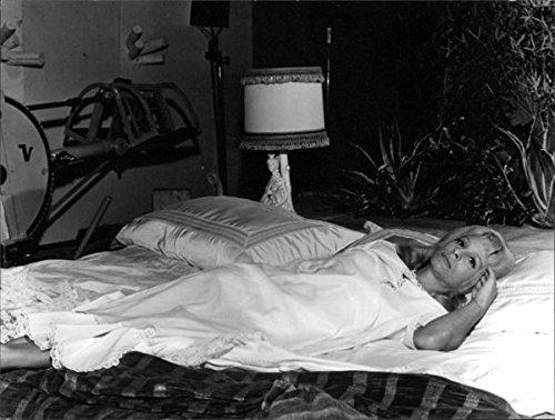 (Vintage photo of Ingrid Thulin on bed.)