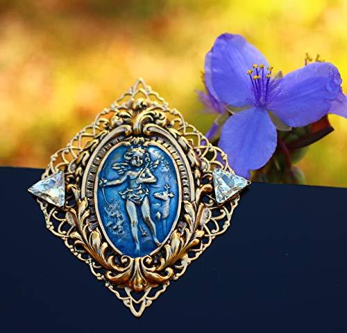 Angel Cupid with deer gold tone filigree blue enamel Brooch by Inga Engele USA 60mm x 52mm