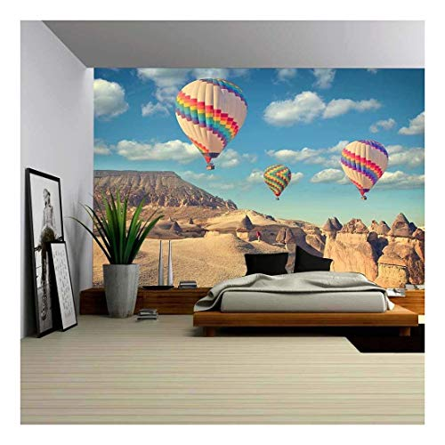 wall26 - Vintage Photo of Hot Air Balloon Flying Over Rock Landscape at Cappadocia Turkey - Removable Wall Mural | Self-Adhesive Large Wallpaper - 100x144 inches