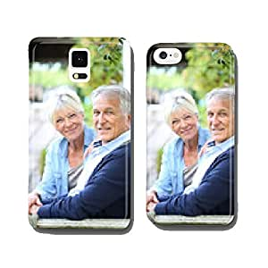Senior couple relaxing on bench by the house cell phone cover case iPhone5