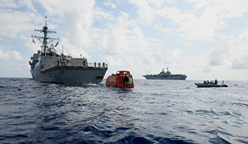 the-guided-missile-destroyer-uss-bainbridge-ddg-96-tows-the-lifeboat-from-the-maersk-alabama-to-t