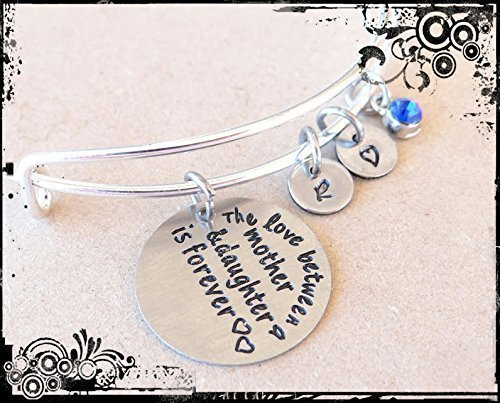 The love between a mother and daughter is forever bracelet//keychain