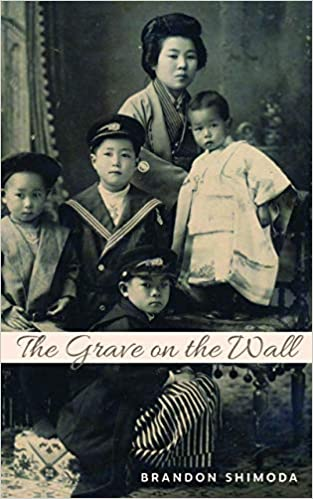 cover image The Grave on the Wall