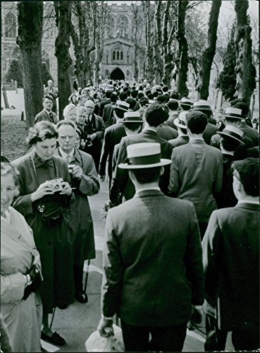 Vintage photo of 1964group of people mostly men trooping towards the church. Many media personality with cameras are lining up in the sideline to take photographs.