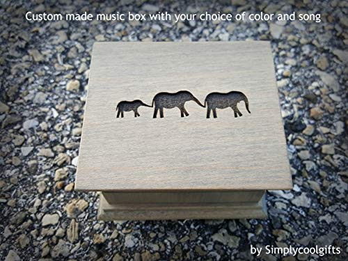 Engraved wooden music box with an elephant family on the top with your customized message on the bottom side of the box, with your choice of color and song