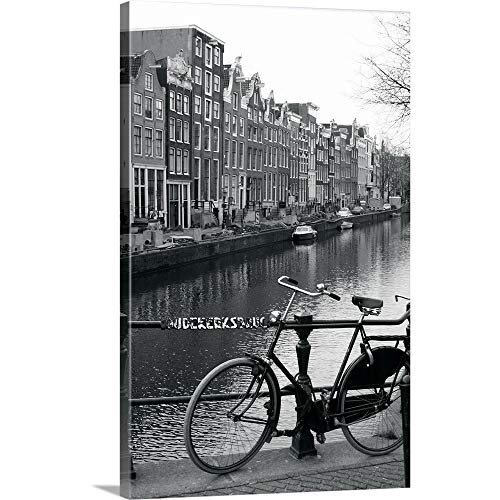 Netherlands, Amsterdam, Bicycle Parked by Canal (B Canvas Wall Art Print, ()