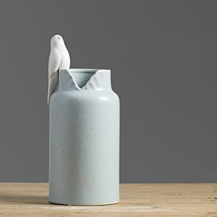 . Amazon com  BHMEI Modern Minimalist Ceramic Bird Vase Nordic Home