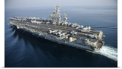 Stocktrek Images Poster Print entitled The aircraft carrier USS Nimitz is underway in the Arabian Gulf by greatBIGcanvas
