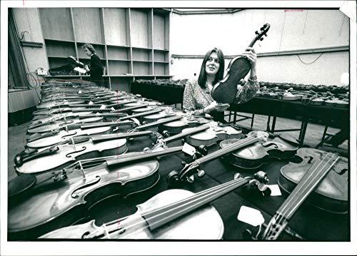 Vintage photo of Musical instruments violine:francess gillham exinpert in christies musical instrument