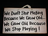 We don't stop playing because we grow sign