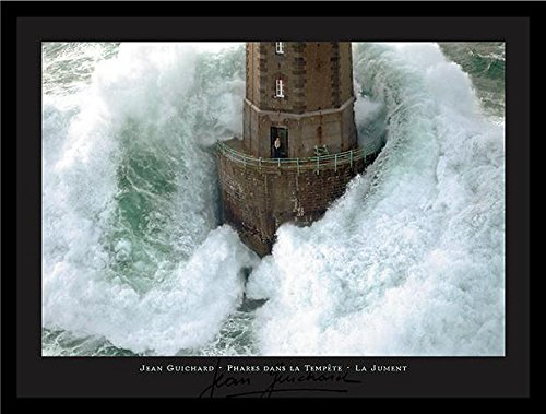 - FRAMED La Jument Phares Dans La Tempete Lighthouse Photograph by Jean Guichard 31.5x23.5 Art Print Poster Wall Decor Famous Image Lighthouse with Crashing Wave Man Standing outside