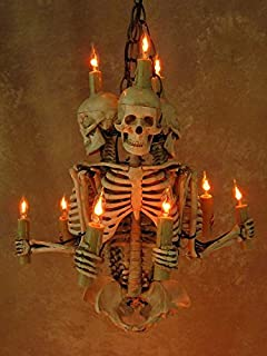 Amazon skull hip bone chandelier home kitchen skeleton chandelier three harvey jr skeletons holding candles aloadofball Image collections